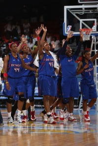 The Detroit Shock celebrating on the Sky's court after eliminating the Sky from the playoffs.